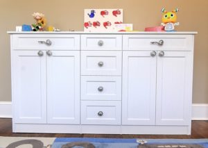 Symmetry closets, custom storage, white cabinets, custom kids storage
