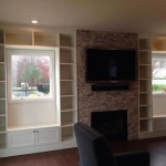 custom entertainment center, brick fire place, white shelving, custom built in