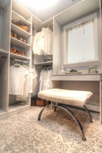 Walk in closet, white shelves, white clothing, makeup bench, custom walk in, custom built ins, custom closet, Symmetry Closets