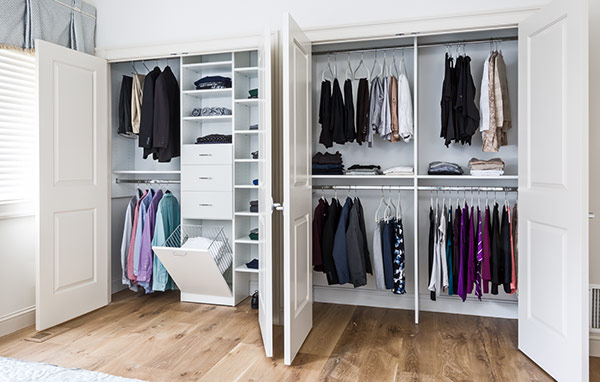 Custom reach in closet, custom closet, custom built in, customer master closet, white closet, double doors, organization, organized clothing