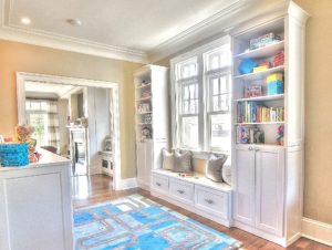 Kids, play area, symmetry closets, custom built ins, white cabinets, organized space, organized kids area, custom bench