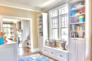Symmetry Closets High End Wall Units, White shaker, Built in storage wall, kids play area, Built-in closet wall units, storage options, crown molding, Bench storage unit, Window seat, bench under window, storage drawers, crown molding