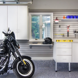 Garage tool, motorcycle, epoxy floor, garage cabinets, slatwall storage